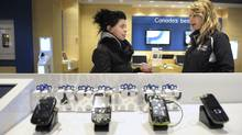 Communications consultant at a Bell Store at the Eaton Centre in 2009. (Fred Lum/Fred Lum/The Globe and Mail)