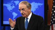 A way forward? U.S. special envoy George Mitchell speaks to reporters ahead of next week's talks (KEVIN LAMARQUE/Reuters)