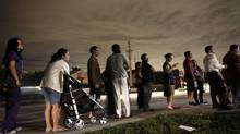 Voters line up in the dark to beat the 7:00 p.m. deadline to cast their ballots at a polling station, Tuesday, Nov. 6, 2012 in Miami. Florida voters queued up before dawn Tuesday to cast their ballots as long lines began forming at some precincts across the state. (Wilfredo Lee/AP)