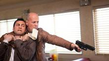 "Joseph Gordon-Levitt and Bruce Willis in a scene from ""Looper"" (Alan Markfield)"