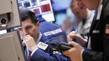 Traders work on the floor of the New York Stock Exchange, March 19, 2012. (BRENDAN MCDERMID/Reuters)