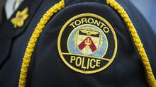 A Toronto Police badge is seen in this file photo. (Mark Blinch For The Globe and Mail)