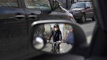 The proposal calls for a parking-protected bike lane on one side of the street, meaning that there would be a line of stationary cars between the cyclists and moving traffic. (Fred Lum/The Globe and Mail)