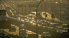 Traffic piles up on the Gardiner Expressway as commuters head home during the evening rush hour in Toronto on March 14, 2011. (Kevin Van Paassen/Kevin Van Paassen/The Globe and Mail)