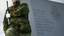 A soldier practices for Remembrance Day ceremonies at the National Military Cemetery in Ottawa on Nov. 10, 2011. (Sean Kilpatrick/THE CANADIAN PRESS)
