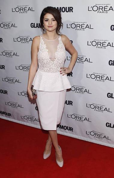 Selena Gomez arrives at the Glamour Magazine Women of the Year Awards in New York on Monday. Being named a Woman of the Year for breaking up with Justin Bieber seems a little sarcastic, but, hey, we don't make the rules here – we just report the news that we make up. (Reuters)