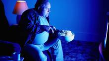 What not to do: eating while watching TV. (PHOTODISC)