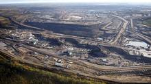 This Sept. 19, 2011 aerial photo shows an oil sands mine facility near Fort McMurray, Alta. (Jeff McIntosh/The Canadian Press/Jeff McIntosh/The Canadian Press)
