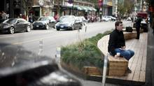 The Urban Pasture Parklet at the 1000-block of Robson Street in Vancouver on Feb. 8, 2014. Street parking spots have been converted to mini public plazas in three locations, with another coming soon to Main Street at East 21st Avenue. (Rafal Gerszak for The Globe and Mail)