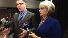 B.C. NDP Leader Adrian Dix, left, and Surrey-area MLA Sue Hammell address reporters on Jan. 15, 2014, after putting forward the party's Surrey Accord proposal to battle crime and other issues. (Andrea Woo/The Globe and Mail)