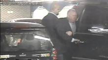 Toronto City Hall surveillance footage, obtained by The Globe and Mail through an access-to-information request, shows a security guard helping Mayor Rob Ford into his brother Doug Ford's Escalade shortly before 10 p.m. on Easter Monday. (CITY OF TORONTO)