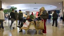 Christmas shoppers crowd a Toronto mall in this photo from last December. (Kevin Van Paassen/The Globe and Mail)