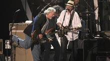 Neil Young and Crazy Horse performing in February, 2012. (Chris Pizzello/AP)