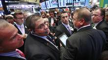Traders on the New York Stock Exchange await the first trade Wednesday of Santander Mexico shares. (Brendan McDermid/Reuters)