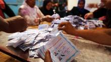 Workers count ballots at a polling station in Cairo on Wednesday during the third day of voting in Egypt's presidential election. (MOHAMED ABD EL GHANY/REUTERS)