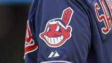 Just before last year's American League Championship Series, Mr. Cardinal filed applications with the Human Rights Tribunal of Ontario and the Canadian Human Rights Commission, objecting to the Indians' team name and its logo, Chief Wahoo, a cartoon depiction of a native with red skin, a hooked nose and toothy grin. (Mark Duncan/The Associated Press)