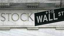 A Wall Street sign is seen outside the New York Stock Exchange March 21, 2007. Stocks ended sharply higher on Wednesday after investors interpreted the Federal Reserve's latest policy statement as leading to a rate cut. The three major indexes each ended up more than 1 percent. REUTERS/Brendan McDermid (UNITED STATES) (BRENDAN MCDERMID/REUTERS)