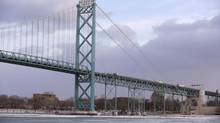 In a photo from Jan. 6, 2015 in Detroit, the Ambassador Bridge leading into Windsor, Ontario is seen from Detroit. The U.S. Department of Homeland Security says the Obama administration and Canada have agreed with Canada for financing a key piece of a planned $2.1 billion bridge connecting Detroit and Windsor, Ontario. (Carlos Osorio/AP)