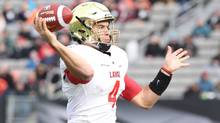 Laval Rouge et Or quarterback Hugo Richard (4) throws during first half U Sports Vanier Cup championship football action against the Calgary Dinos, in Hamilton, Ont., on Saturday, November 25, 2016. (Peter Power/THE CANADIAN PRESS)