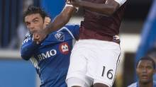 Colorado Rapids' Clint Irwin out jumps Montreal Impact's Andrea Pisanu for the header during first half MLS action in Montreal on Saturday, June 29, 2013. (Peter Mccabe/THE CANADIAN PRESS)