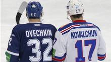 Dynamo Moscow's Alexander Ovechkin (L) and SKA St. Petersburg's Ilya Kovalchuk skate during their Kontinental Hockey League (KHL) game in Moscow September 23, 2012. (Reuters)