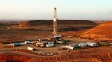Drilling rig over the heijah feild in Yemen. (Courtesy of Nexen Inc.)