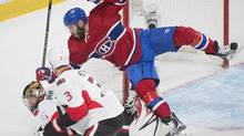 The Montreal Canadiens' Dwight King collides with Ottawa Senators goaltender Craig Anderson as the Senators' Marc Methot defends their matchup in Montreal on Sunday. (Graham Hughes/THE CANADIAN PRESS)