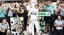 Mercedes Formula One driver Lewis Hamilton of Britain is sprayed with champagne by his team after his win in the Bahrain F1 Grand Prix. (THAIER AL-SUDANI/REUTERS)
