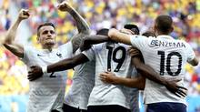 France's Paul Pogba (19) celebrates with teammates after scoring his side's opening goal during the World Cup round of 16 soccer match between France and Nigeria at the Estadio Nacional in Brasilia, Brazil, Monday, June 30, 2014. (Associated Press)