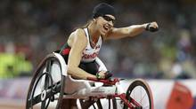 Canada's Michelle Stilwell celebrates after winning the women's 200m T52 final race at the 2012 Paralympics in London, Saturday, Sept. 1, 2012 (AP)