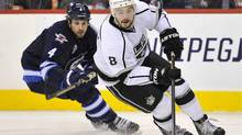 The Winnipeg Jets' Zach Bogosian chases Drew Doughty of the L.A. Kings in Winnipeg, Dec. 29, 2011. (FRED GREENSLADE/Fred Greenslade/Reuters)