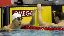 Scott Dickens, left, celebrates his victory in the men's 200 metre breaststroke as Mike Brown reacts to a fourth place finish at the Canadian Olympic Swimming Trials Thursday, March 29, 2012 in Montreal. (Paul Chiasson/THE CANADIAN PRESS)