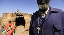 A South Sudanese man stands outside his shelter in Diling, in South Kordofan, on the border between South and North Sudan, January 10, 2011. (ZOHRA BENSEMRA/REUTERS)