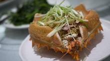 Crab juice noddles served in a Alaskan King Crab shell at the Red Star Seafood Restaurant in Vancouver. (John Lehmann/The Globe and Mail)