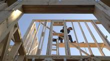 Construction worker David Rager, 53, frames a window in the upper floor of a two-story custom home being built in Orlando, Fla., Friday, Feb. 13, 2015. As construction jobs return in some regions, competition for skilled labor is heating up. (Phelan M. Ebenhack/AP)