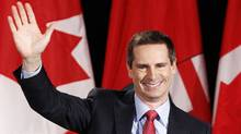Liberal leader Dalton McGuinty waves at his Ontario election night headquarters in Ottawa October 6, 2011. (REUTERS/Chris Wattie/REUTERS/Chris Wattie)