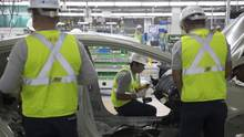 Workers check the chassis of a vehicle during a test at the Kia Motors Corp. assembly plant in Pesqueria, Mexico, on Monday, Dec. 14, 2015. (Susana Gonzalez/Bloomberg)