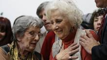 Estela de Carlotto, president of Grandmothers of Plaza de Mayo, right, reacts before a news conference in Buenos Aires, Argentina, Tuesday, August 5, 2014. Carlotto, one of the most prominent human rights activists in Argentina, has located the grandson born to her daughter Laura in captivity during the military dictatorship that ruled Argentina from 1976-1983. (VICTOR R. CAIVANO/ASSOCIATED PRESS)