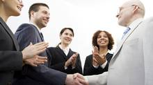 Business people shaking hands (Photos.com)