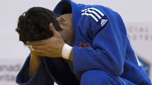 Canada's Sergio Pessoa reacts after losing to Brazil's Felipe Kitadai in their under 60kg final match at the Pan American Judo Championship in Montreal April 28, 2012. REUTERS/Olivier Jean (Olivier Jean/Reuters)