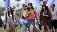 Coachella festivalgoers arrive at Empire Polo Field on day one of the 2014 Coachella Music and Arts Festival on Friday, April 11, 2014, in Indio, Calif. (Photo by Chris Pizzello/Invision/AP) (Chris Pizzello/Chris Pizzello/Invision/AP)