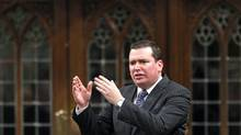 Then-Public Works minister Christian Paradis speaks during Question Period in the House of Commons on October 27, 2009.