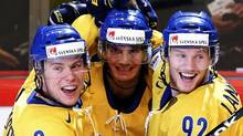 Sweden's Loui Eriksson (C) celebrates his goal against Switzerland with teammates Erik Gustafsson and Gabriel Landeskog during their 2013 IIHF Ice Hockey World Championship final match at the Globe Arena in Stockholm May 19, 2013. (GRIGORY DUKOR/REUTERS)