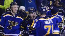 St. Louis Blues left wing Alexander Steen celebrates with defenseman Jay Bouwmeester centre Patrik Berglund and centre Vladimir Sobotka after he scored an empty net goal against the Minnesota Wild during the third period. (Jeff Curry/USA Today Sports)