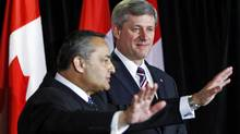 Prime Minister Stephen Harper and master of ceremonies Thomas Saras attend the National Ethnic Press and Media Council of Canada gala dinner in Markham, Ont., on Nov. 21, 2009.