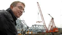 "Ross Crockford, director of the johnsonstreetbridge.org watches as a massive crane lifts a 250-tonne section of Victoria's iconic ""blue bridge"" on to a barge below. (Diana Nethercott/Diana Nethercott)"