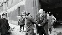 It was Sergeant Albert Lisacek , shown here manhandling Paul Rose, one of the men who killed Quebec Labor Minister Pierre Laporte, who led the FLQ raid efforts. (© Bettmann/CORBIS)