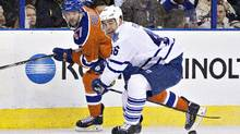 Toronto Maple Leafs' Roman Polak (46) battles for the puck with Edmonton Oilers' Benoit Pouliot (67) during first period NHL action in Edmonton, Alta., on Thursday February 11, 2016. (JASON FRANSON/THE CANADIAN PRESS)