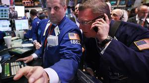 Traders on the floor of the New York Stock Exchange on March 13, 2012.