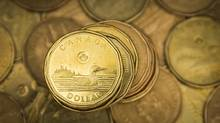 A Canadian dollar coin, commonly known as the loonie, is pictured in this January 23, 2015, file photo. (MARK BLINCH/REUTERS)